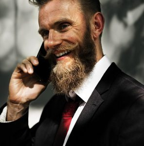 what do beard oils do - beard man on phone